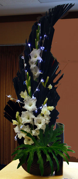Bride - one side of a duo design contrived flowers may be used